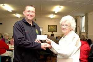 Mark Tolan receiving a cheque from Binley Woods